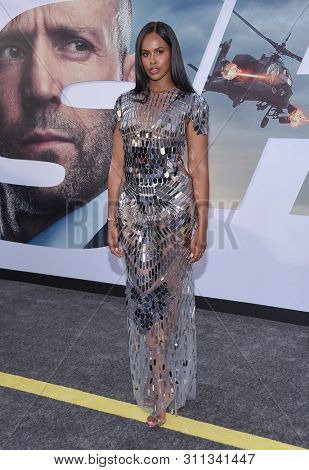LOS ANGELES - JUL 13:  Sabrina Dhowre arrives for the 'Fast & Furious Presents: Hobbs and Shaw' World Premiere on July 13, 2019 in Hollywood, CA