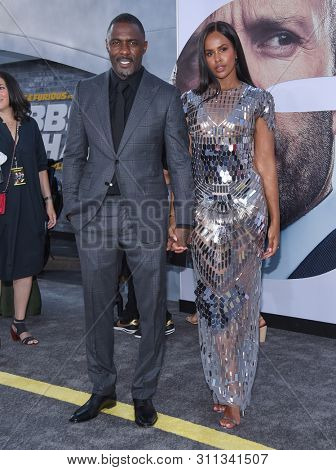 LOS ANGELES - JUL 13:  Idris Elba and Sabrina Dhowre arrives for the 'Fast & Furious Presents: Hobbs and Shaw' World Premiere on July 13, 2019 in Hollywood, CA