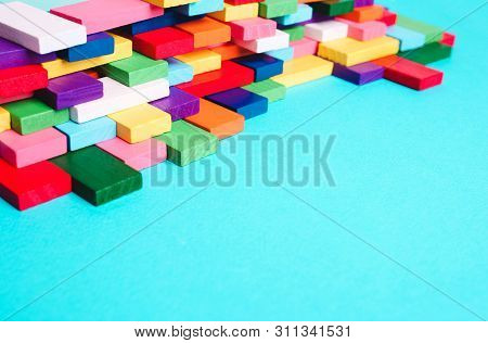 Colored Dominoes In The Puzzle. Concept Of Creativity, Art, Order, Business Organization