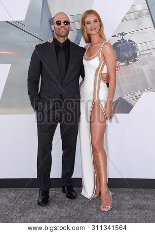 LOS ANGELES - JUL 13:  Jason Statham and Rosie Huntington-Whiteley arrives for the 'Fast & Furious Presents: Hobbs and Shaw' World Premiere on July 13, 2019 in Hollywood, CA