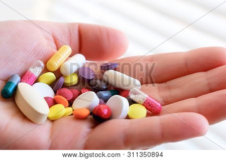 Biologically Active Additive. Handful Of Pills In His Hand. Pharmacology Of Shadow Production. Place