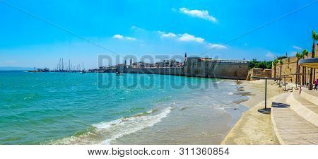 Acre, Israel - July 08, 2019: Panoramic View Of The Horses Beach, The Sea Wall And The Fishing Port,