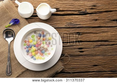 Thai Sweets And Colorful Ball Flour In A White Cup On Asackcloth,  On An Old Wooden Table Rainbow Sw