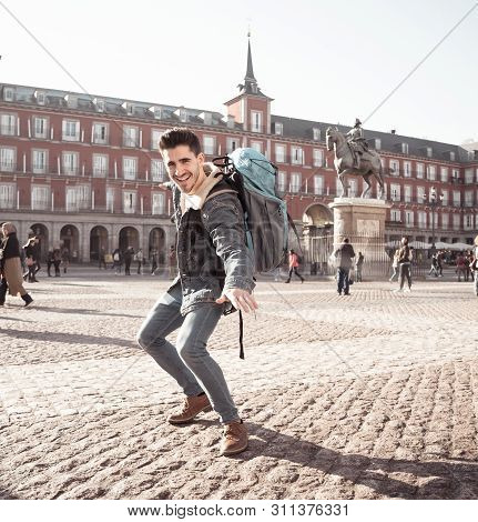 Happy Student Having Fun In Madrid, Spain Europe. In Surfing The World Concept
