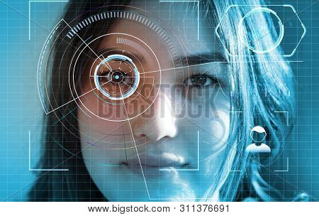Futuristic And Technological Scanning Of The Face Of Beautiful Woman For Facial Recognition And Scan