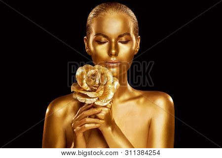 Gold Fashion Model Beauty Portrait With Rose Flower, Golden Woman Art Luxury Makeup On Studio Black