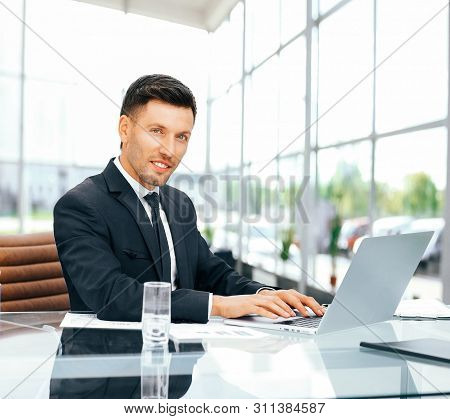 Employee Works With Documents In A Spacious Office  Glass