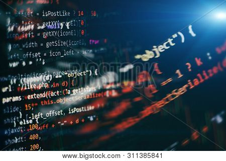 Website HTML Code on the Laptop Display Closeup Photo. Desktop PC monitor photo. Javascript functions, variables, objects. poster