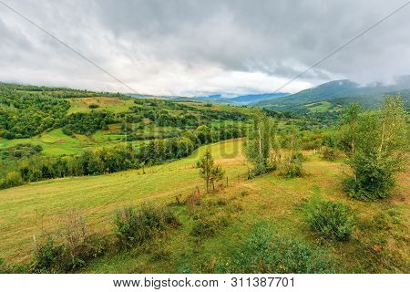 Beautiful Countryside On An Overcast Day. Carpathian Rural District In Mountains. Overcast Rainy Sep