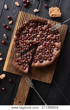 Homemade Comfort Food. Flatlay Of Chocolate Pie With Tart Cherries With Cocoa Beans And Cane Sugar O