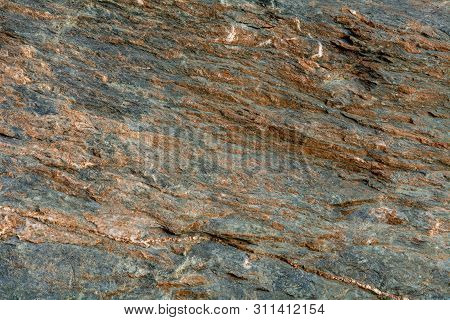 Gneiss, A Common Type Of Metamorphic Rock, Is Formed By High Temperature And High-pressure Metamorph