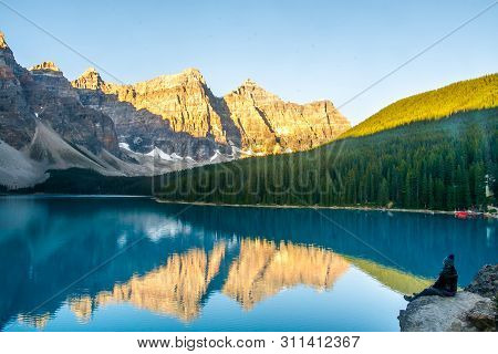 The Shot Was Taken During The Morning Queue At Sunrise On Moraine Lake In Banff National Park.exciti