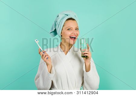 Attractive Woman Cleaning Teeth In Bathroom. Morning Routine Of Washing Teeth. Smiling Girl Brushing