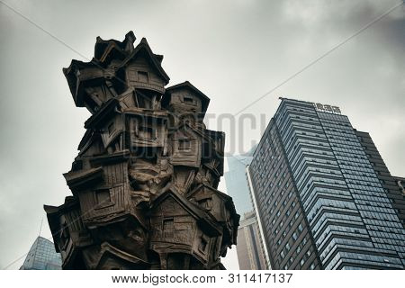 CHONGQING, CHINA – MARCH 13: Sculpture in Hongyadong shopping complex on March 13, 2018 in Chongqing. With 17M population, it is the most populous Chinese municipality.