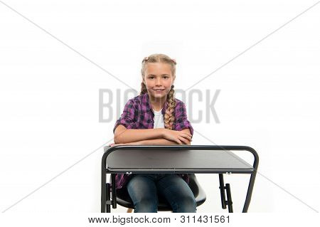 Back To School. Cute School Child Sitting At Desk Isolated On White. Little Schoolgirl Having Lesson