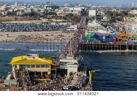 Santa Monica, California, USA - August 6, 2016:  Aerial of crowds of people on popular Santa Monica Pier near Los Angeles.