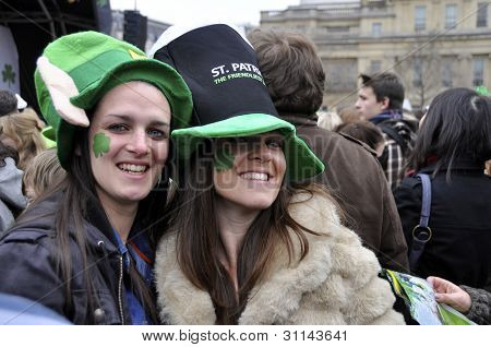 LONDON - MARCH 18: Two smiling girls during the St Patrick's Day Parade and Festival at Trafalgar Square on March 18, 2012 in London, UK.