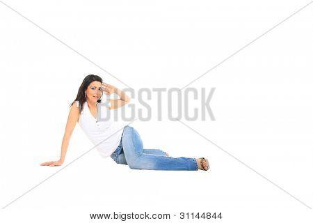 Foto stock de jóvenes, en forma y sexy mujer en jeans y top blanco aislado en blanco