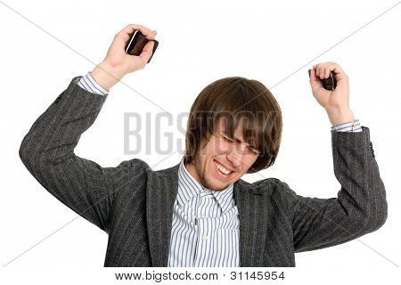 Frustrated businessman holding a mobile in his raised hands.