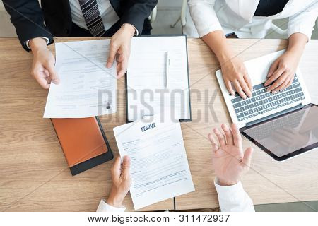 Serious Man Has A Business Meeting Reading A Resume About Hiring Decision During A Job Interview In