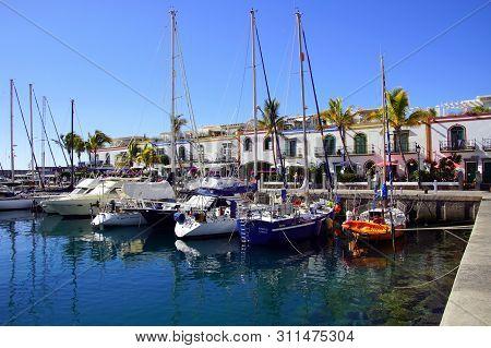 Puerto De Mogan, Gran Canaria, Spain - December 31, 2018: Boats In The Harbor Of Puerto De Mogan, Gr