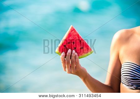 Watermelon Slice In Woman Hand Over Sea - Pov. Summer Beach Concept. Tropical Fruit Diet