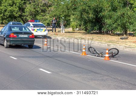 Odessa, Ukraine - June 13, 2019: Fatal Accident Car With A Bicycle On A High-speed Highway. Ricked B