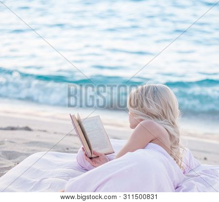 Relax Concept. Cozy And Comfortable Bed Near The Sea. Summer Vacations Still Life. Woman Reading A B