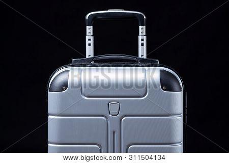 Luggage Suitcase For Travel On Black Background. Trip Handbag. Travel Bag