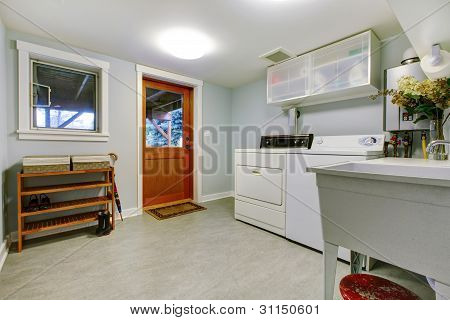 Large Blue Laundry Room Interior With Sink.