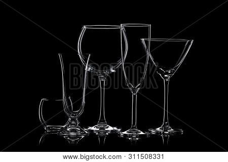 Empty Cocktail Glassware On A Black Background.