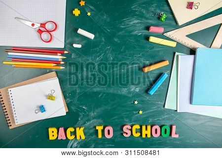 Still Life With School Supplies. Blackboard In Chalk Chalkboard. Green Background. Notebooks, Notebo