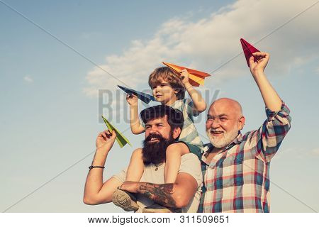 Happy Child Playing Outdoors. Happy Man Family Have Fun Together. Kids Playing With Simple Paper Pla