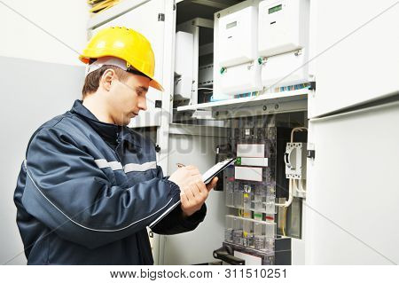 electrician engineer worker inspecting electrical data