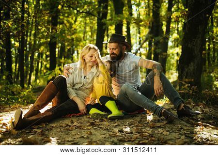 Family Day Concept. Happy Family With Kid Boy Relaxing While Hiking In Forest. Mother Father And Sma