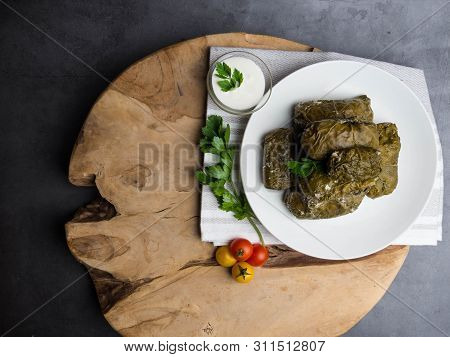 Delicious Dolma Sarma Stuffed Grape Leaves Rice, White Yogurt Sauce. Lebanese Dolma Sarma On Plate.