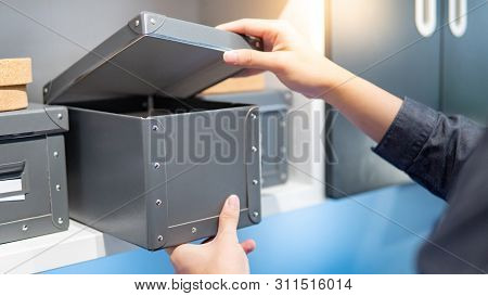 Male Hand Opening Gray Paper Box On Shelf. Packaging Design For Home Decoration Or Office Supplies.