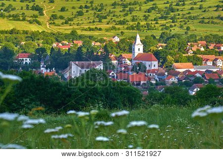 Rimetea Village (torocko In Hungarian Or Eisenmarkt, Eisenburg, Traschen In German) With White Churc