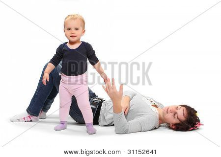 A mother teaching her child how to making first steps. Happy family concept.