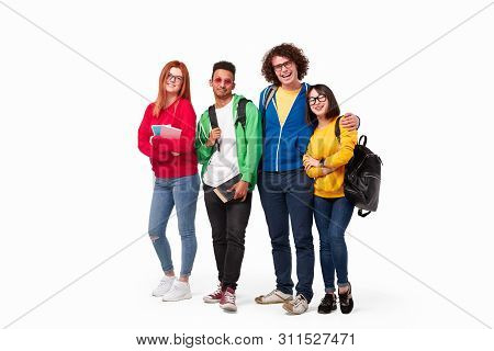 Full Body Multiracial Young Friends With Backpacks And Notebooks Smiling At Camera Against White Bac