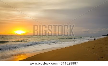 Tropical Beach Sunset With Wave In The Sea At Maichao Beach In Phuket City, Thailand