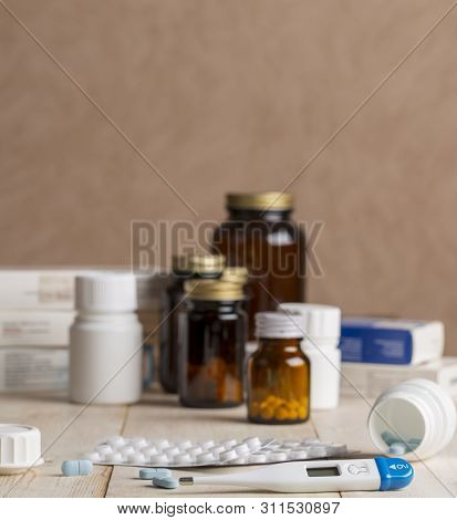 A Group Of Boxes Of Medicines, Pill Bottles, Thermometer And Blisters Of Pills