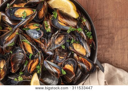 Marinara Mussels, Moules Mariniere, With Lemon Slices, In A Cooking Pot, Overhead Close-up View, Sho