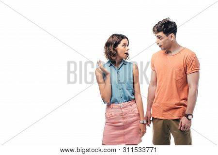 Young, Discouraged Man And Woman Looking At Each Other Isolated On White