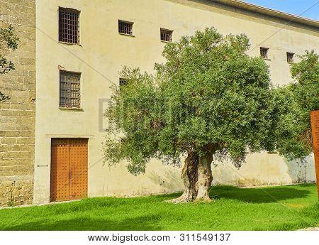 El Puerto de Santa Maria, Spain - June 23, 2019. Principal facade of The Prison of El Puerto de Santa Maria (El Penal del Puerto) was a famous Francoist dictatorship prison. Monastery of Victory, El Puerto de Santa Maria, Cadiz. Andalusia, Spain.