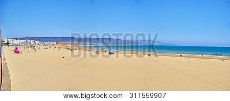 Barbate, Spain - June 25, 2019. Panoramic view of the Barbate beach. View from Promenade. Barbate, Andalusia, Spain.