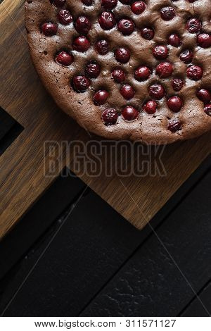 Yummy Homemade Chocolate Cake With Cherries On Oak Board On Black Background Top View Copy Space