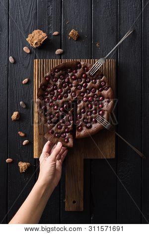 Indulgent Chocolate Dessert. Thin Woman Hand Reaching For Chocolate Cake With Cherries And Cane Suga