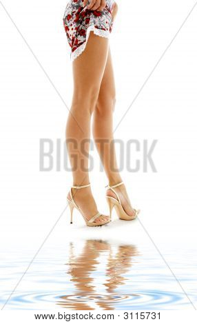 Lace Dress And Golden Heels On White Sand