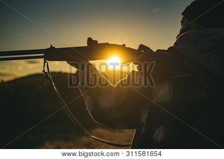 Hunter With Shotgun Gun On Hunt. Hunter In The Fall Hunting Season. Closed And Open Hunting Season.